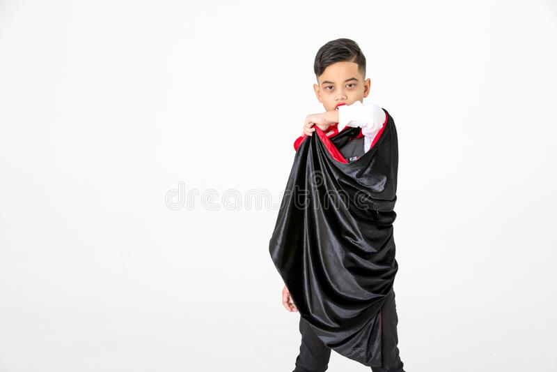 演播室孩子男孩射击画象作为穿戴的服装的尊敬 免版税图库摄影