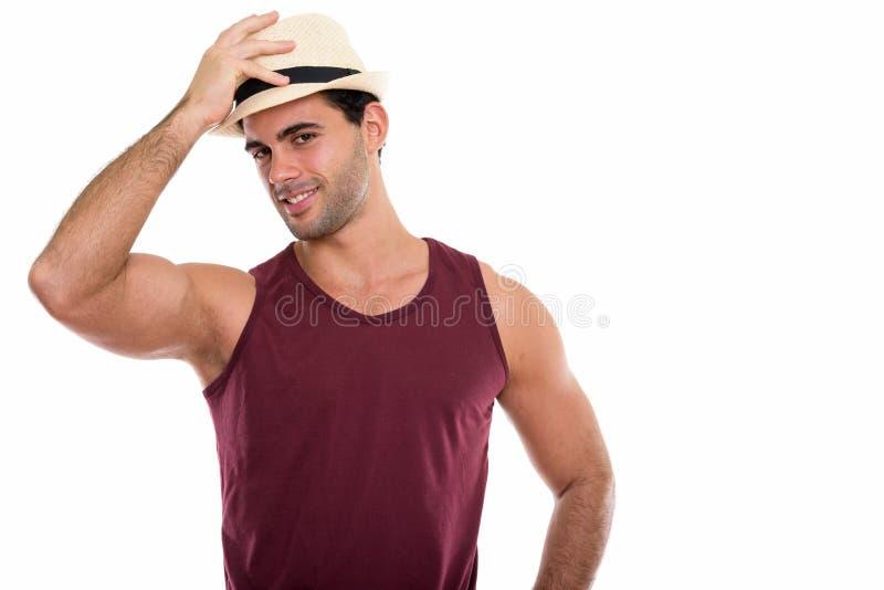 演播室微笑射击了年轻愉快的西班牙的人,当拿着ha时 免版税库存图片