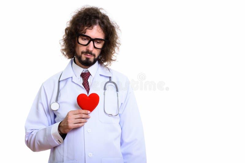 演播室被射击拿着红心的人医生看起来哀伤 库存照片