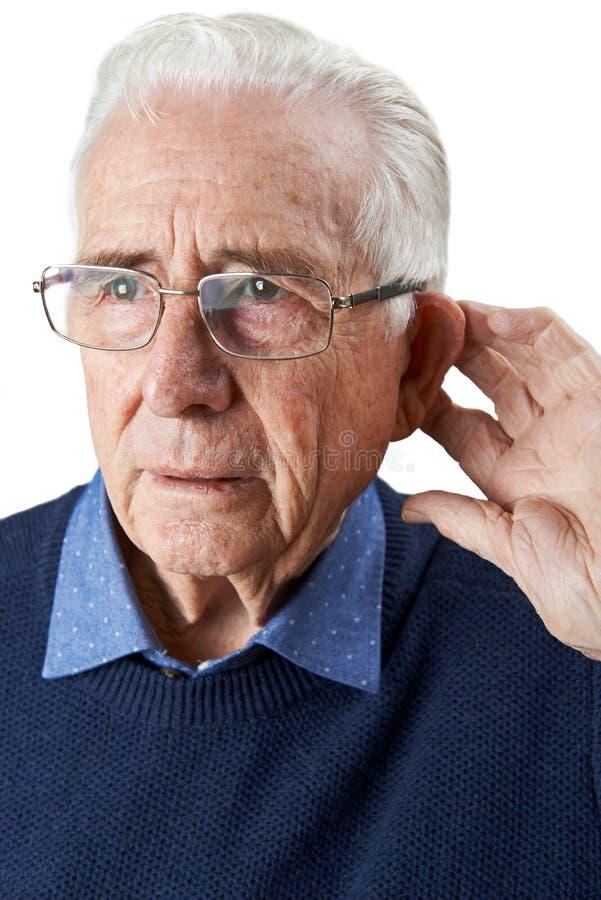 演播室遭受聋的被射击老人 库存图片