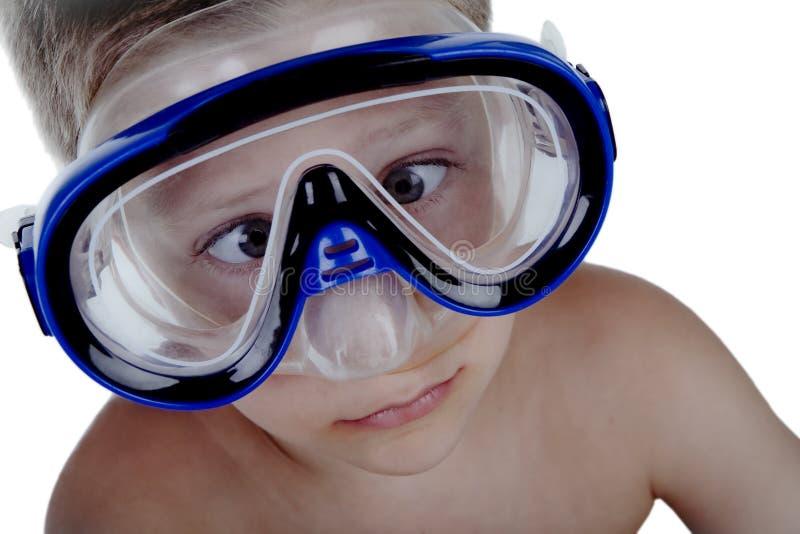 潜航男孩表达式滑稽的做的屏蔽 免版税图库摄影
