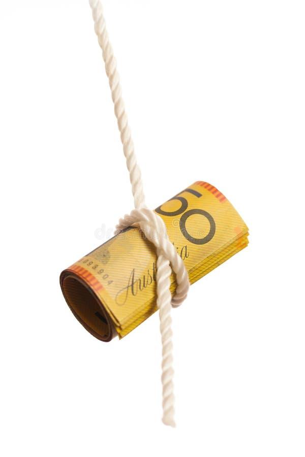 澳大利亚人垂悬从绳索的五十美元笔记 免版税图库摄影