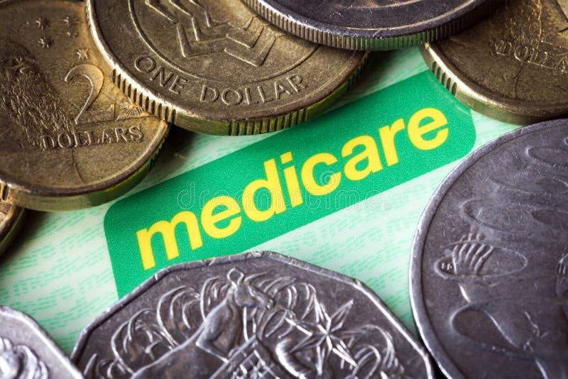 澳大利亚人医疗保障卡片和金钱 免版税库存图片