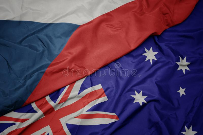 澳大利亚的挥动的五颜六色的旗子和捷克共和国国旗  免版税库存图片