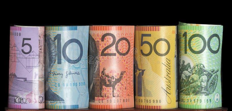 澳大利亚笔记滚动了黑背景 免版税库存图片
