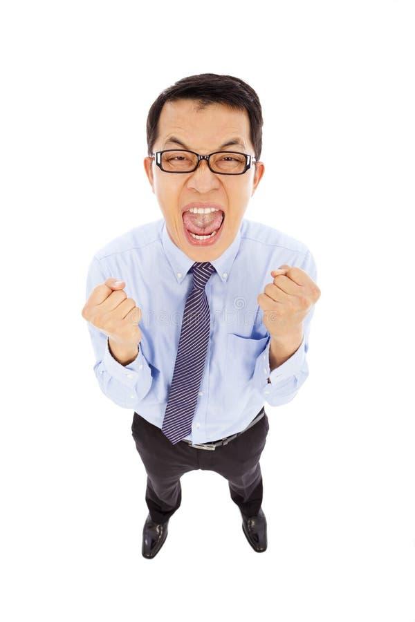 激动和愉快的商人做一个拳头叫喊 图库摄影