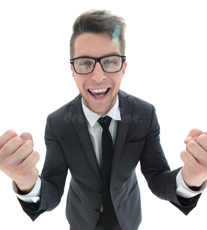 激动的商人庆祝成功 隔绝在白色backg 免版税库存图片