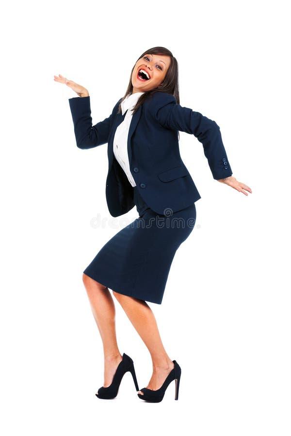 激动的女实业家跳舞 免版税库存照片