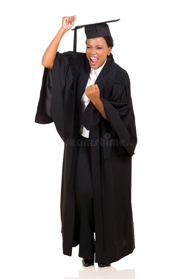 激动的非洲女性毕业生 免版税图库摄影