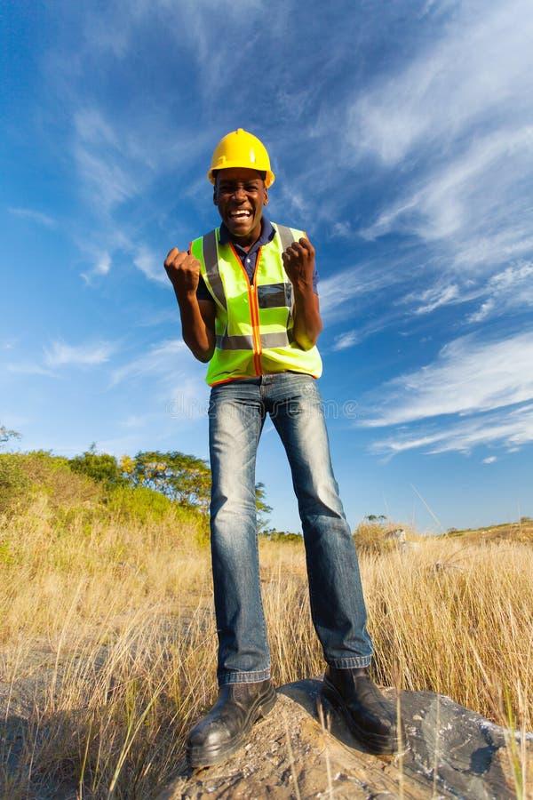 激动的建筑工人 免版税库存图片