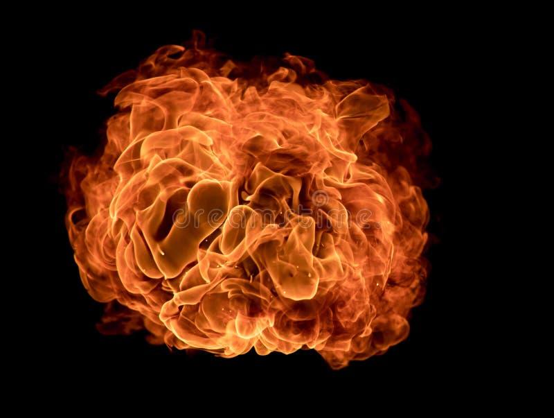 火发火焰在黑背景的纹理 免版税库存照片