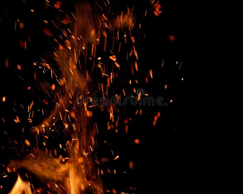 火火焰与火花的在黑背景 免版税库存图片