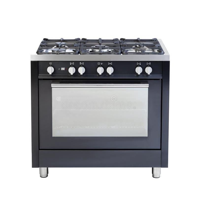 火炉和烤箱在白色隔绝的一套有用的厨具 库存照片