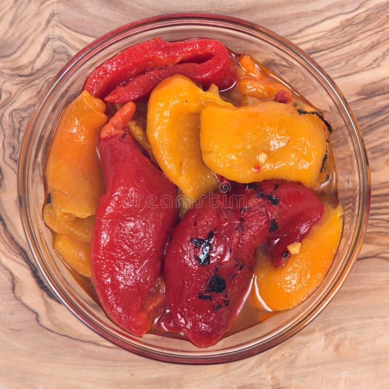 火烤黄色和红辣椒 库存图片