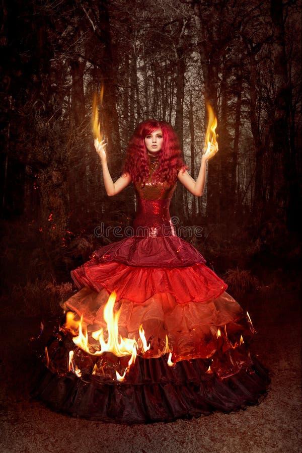 火的妇女 库存照片