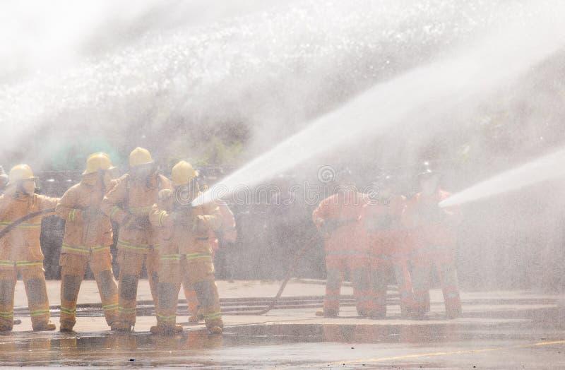 火的消防员 库存照片