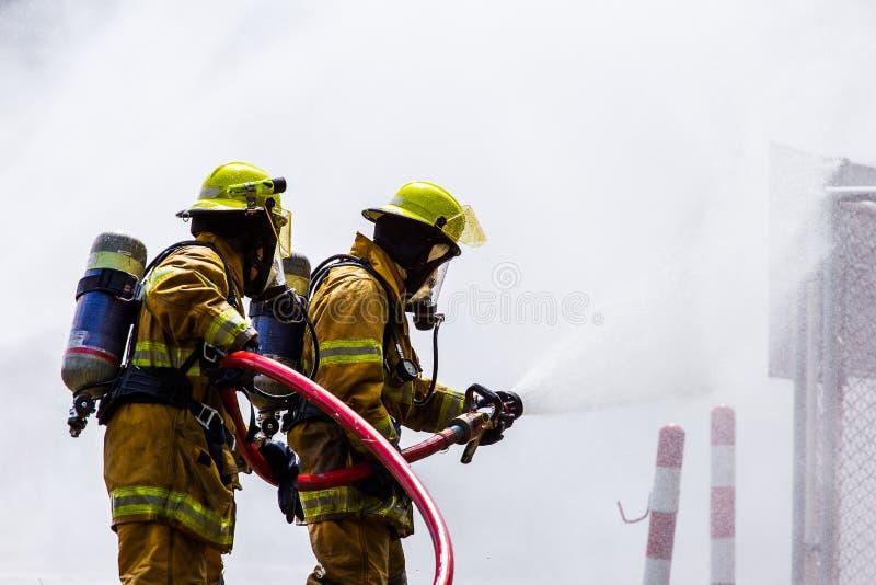 火的消防员 免版税图库摄影