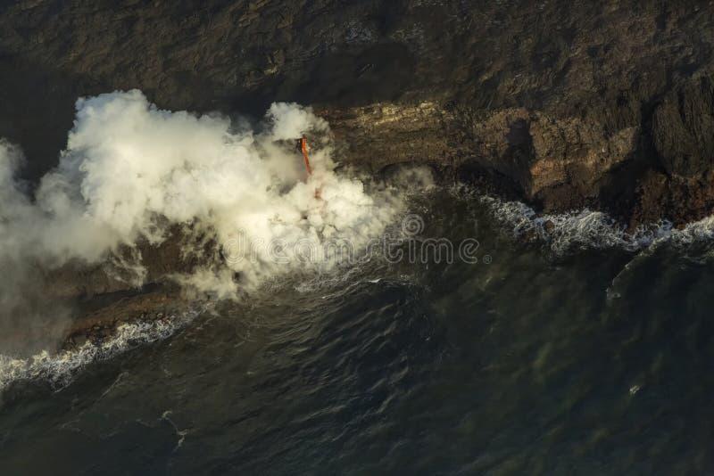 灭火水龙带熔岩流 库存照片