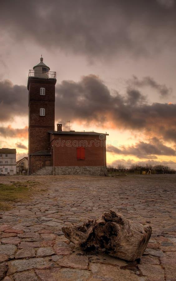 灯塔红色天空 库存照片