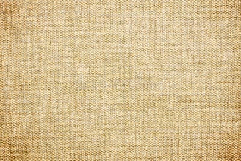 灰棕色上色了亚麻制纹理或葡萄酒帆布背景 免版税库存图片