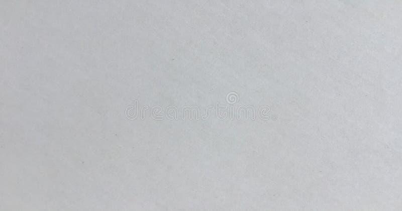 灰色册页纸板加工印刷纸纹理,水平的明亮的概略的老被回收的织地不很细空白的空的难看的东西拷贝空间背景, la 免版税库存照片
