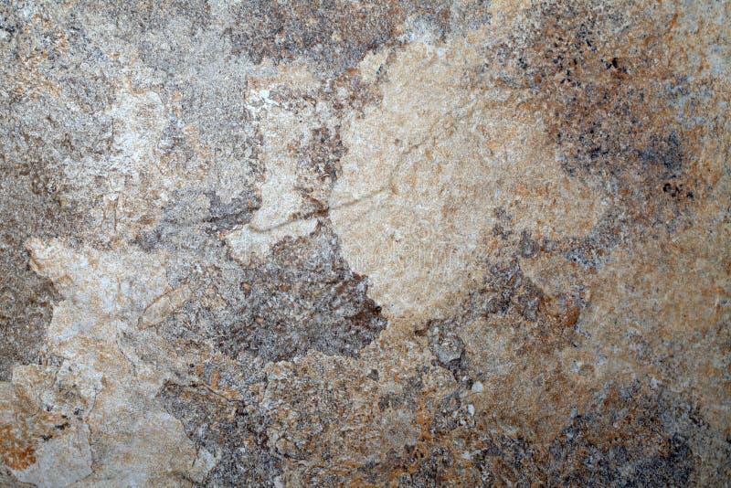 灰色和米黄板岩石头织地不很细背景 库存照片