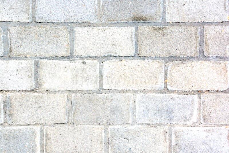 灰色墙壁由大砖做成 砖砌的纹理 空的背景 库存图片