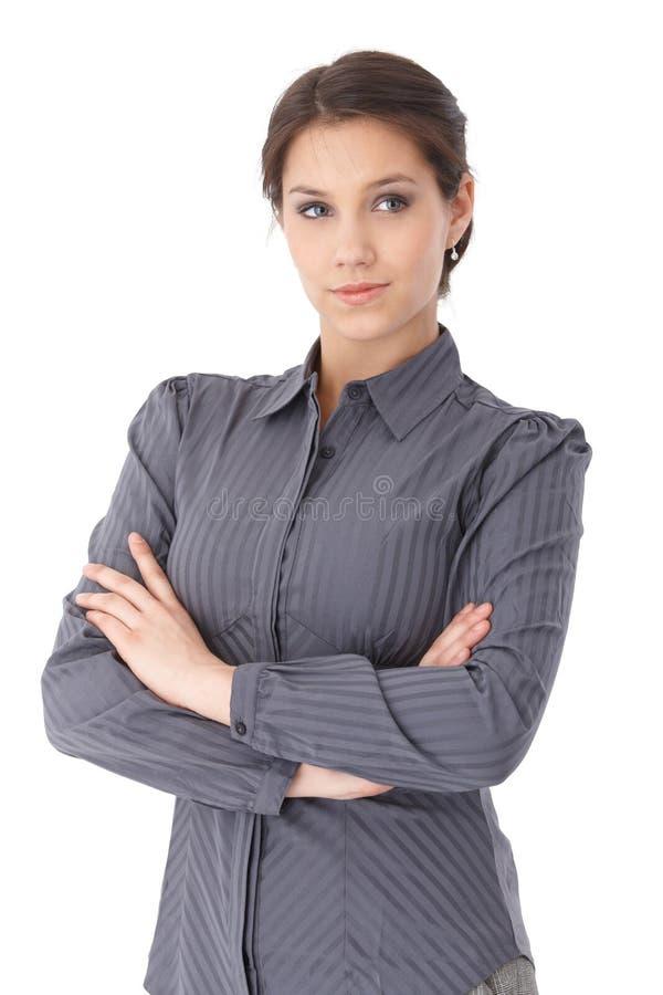 灰色女衬衫的俏丽的妇女 免版税库存照片