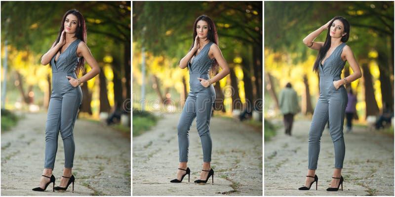 灰色摆在的美丽的妇女在秋季公园 花费时间的年轻深色的妇女在秋天期间在森林里 免版税库存照片