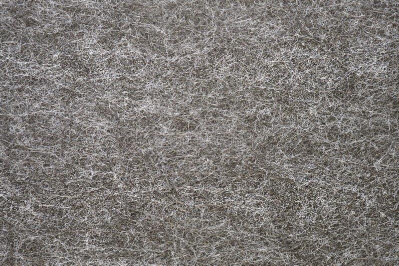 灰色支持被翻转的地毯  免版税库存照片
