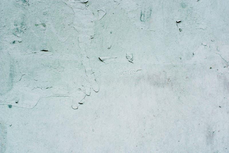 灰色灰泥的背景涂上了并且绘了水泥外部,粗砺的塑象  免版税库存照片