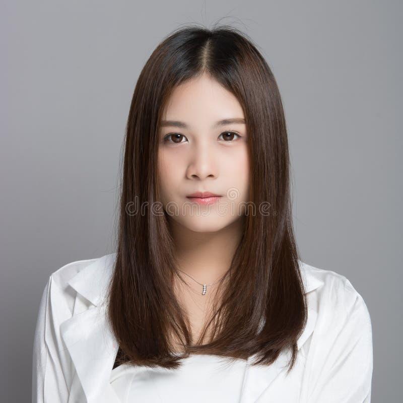 灰色的亚裔妇女 库存照片