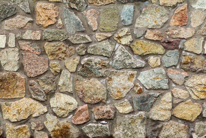 灰色石墙的片段 正面图 免版税图库摄影