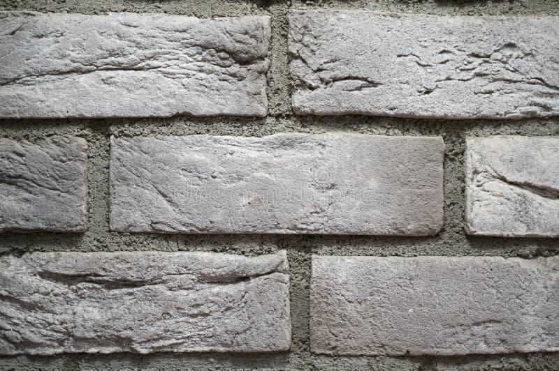 灰色砖墙关闭 普遍葡萄酒背景 免版税库存照片