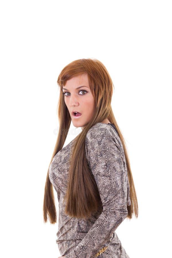 灰色礼服的惊奇的俏丽的女孩 库存图片