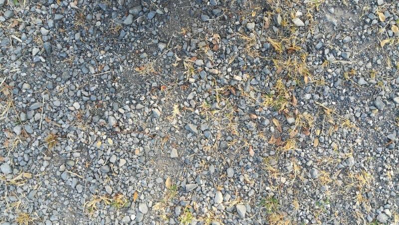 灰色粗砺的石渣地面纹理背景表面 免版税库存照片