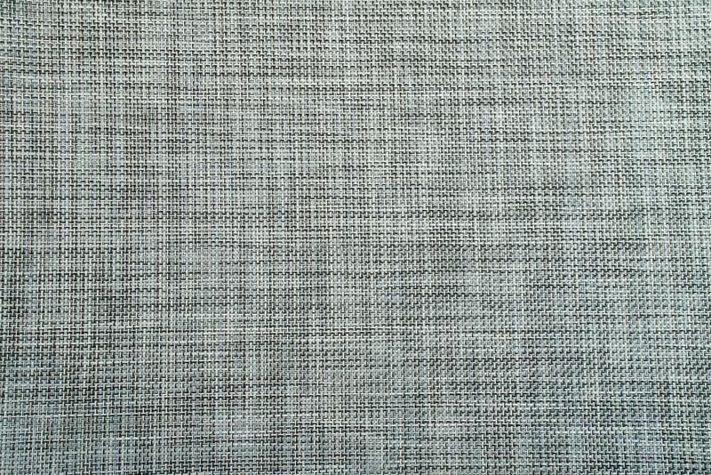 灰色织地不很细织品背景艺术 免版税库存照片