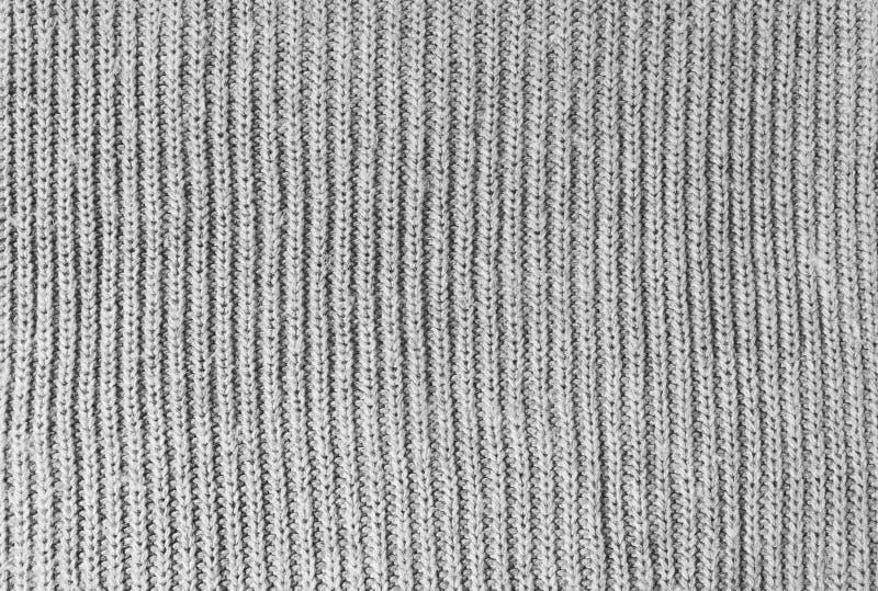 灰色羊毛针织品织品纹理 毛线衣,被编织的样式背景特写镜头  冬天设计 平的位置,顶视图 免版税库存照片