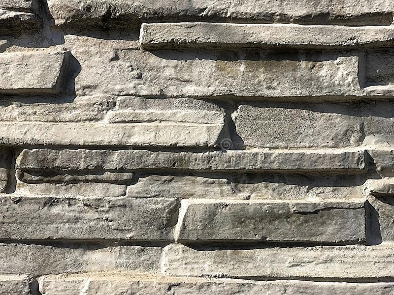 灰色背景,篱芭,石背景 图库摄影