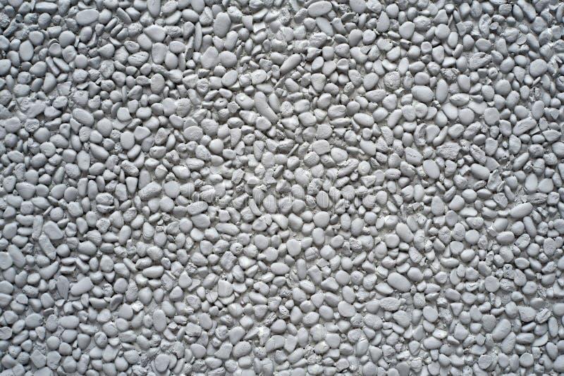 灰色被绘的小卵石石墙 免版税库存照片