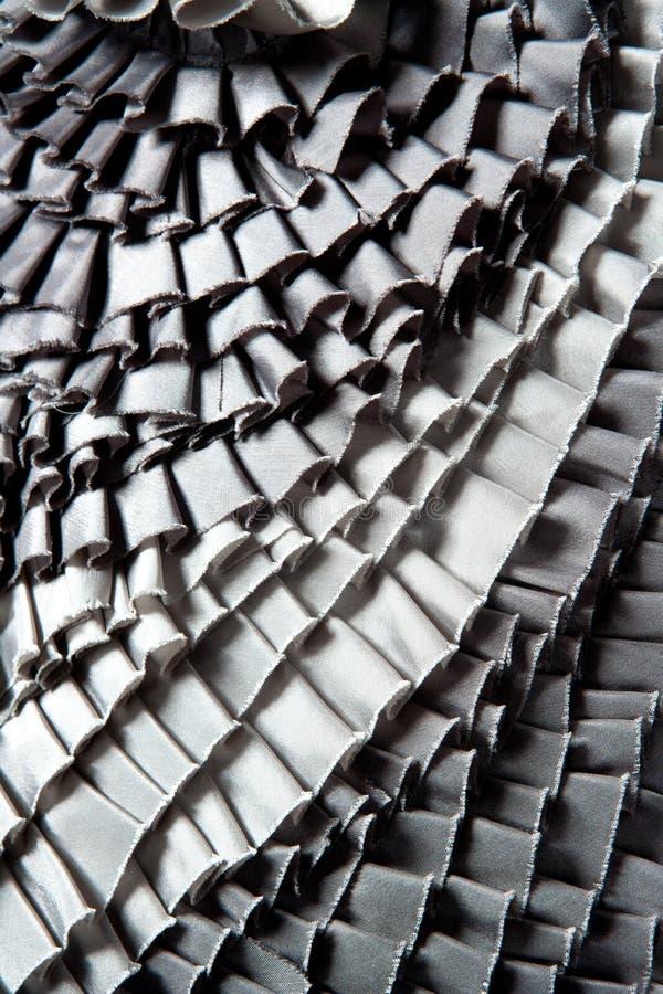 灰色被翻动的裙子被打褶的纹理 库存照片