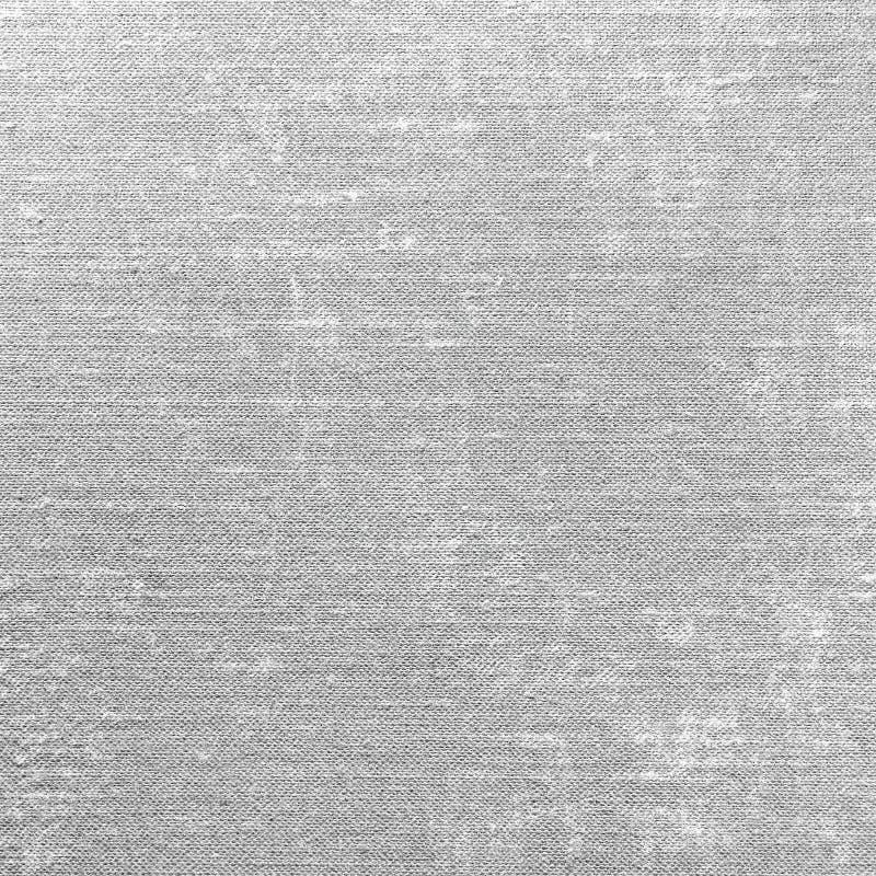 灰色难看的东西亚麻制纹理,灰色织地不很细粗麻布织品背景样式,大详细的宏观特写镜头 库存照片