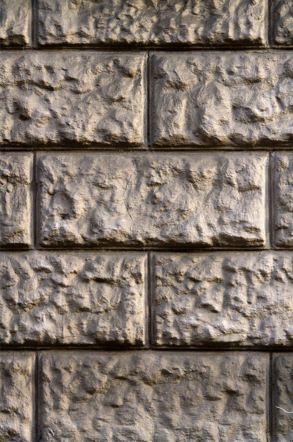 灰色黄色石头墙壁  免版税图库摄影