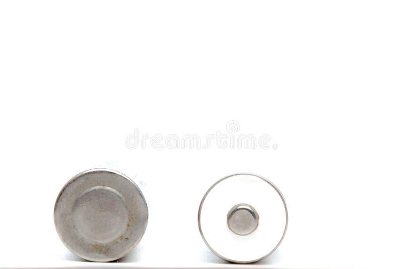 灰色AA电池的关闭在与裁减路线的白色背景 免版税图库摄影