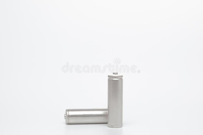 灰色AA电池的关闭在与裁减路线的白色背景 免版税库存照片