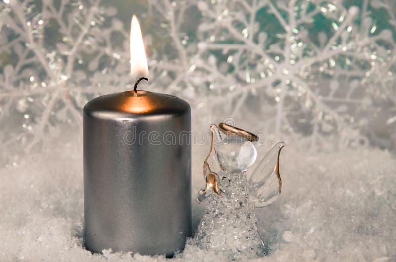 灼烧的蜡烛和天使 库存照片