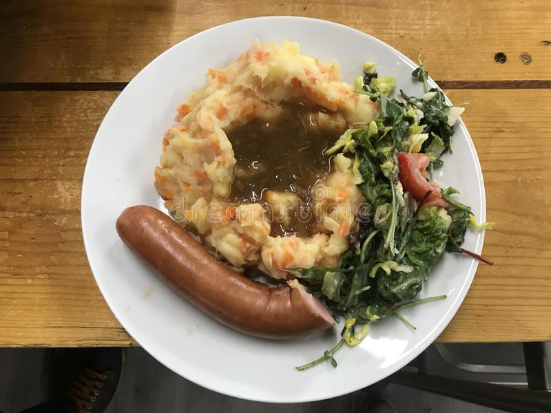 炖煮的食物用葱和红萝卜 库存照片