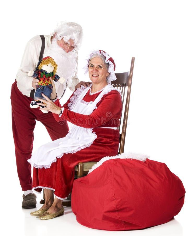 炫耀圣诞老人的工作 图库摄影