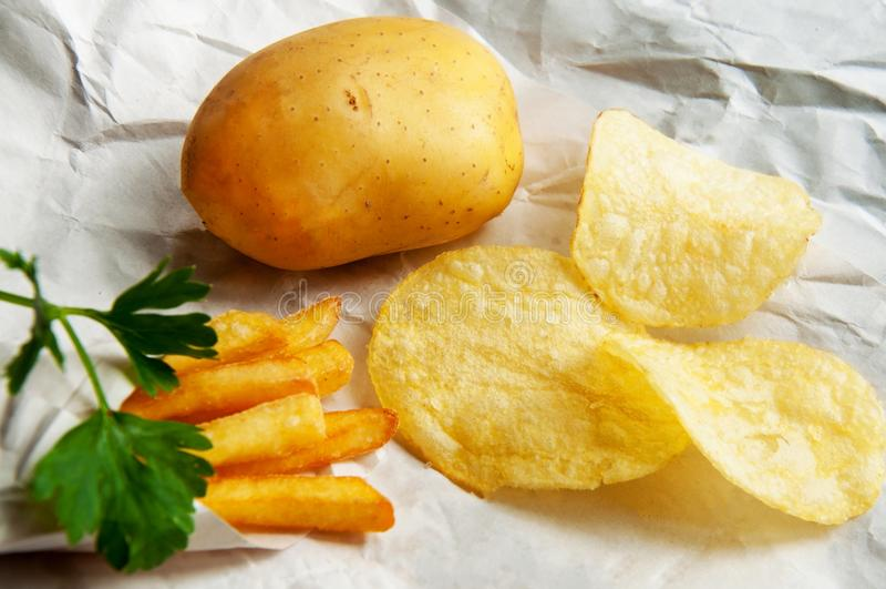 炸薯条土豆,芯片,整个土豆 快餐 库存照片