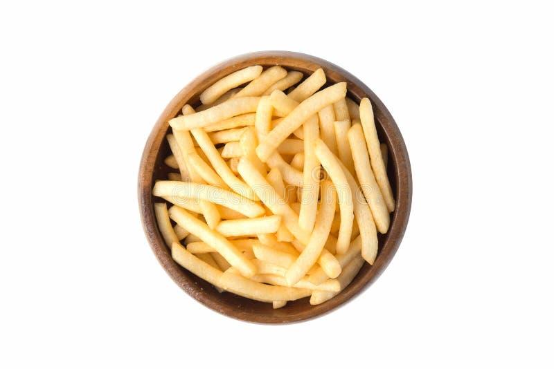 炸薯条或土豆油炸物在白色背景隔绝的木碗 免版税库存图片